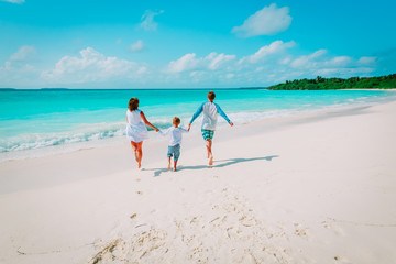 happy family with kid play run on beach
