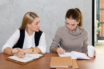 Two women are studying and teaching