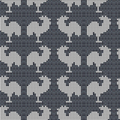 Knitting gray with roosters. Seamless pattern background. Handmade knitwear. Vector illustration.