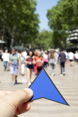 man with a blue arrow in Las Ramblas, Barcelona.
