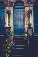 Glasgow Tenement Front Door and Stairs With Spring Flower Pots