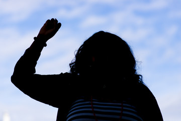 Silhouette of a Woman with a Raised Fist