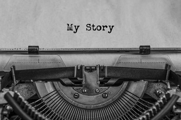 My Story typed text on a vintage typewriter. old paper. Close up. history