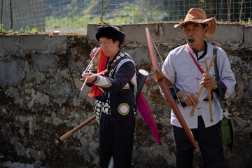 Ethnic Lisu men attend a crossbow shooting competition in Luzhang township of Nujiang Lisu Autonomous Prefecture in Yunnan province