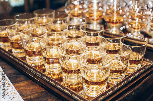 Stylish Glasses With Cognac Or Whiskey On Table At Wedding Reception