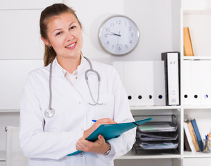 Doctor is signing patient`s diagnosis
