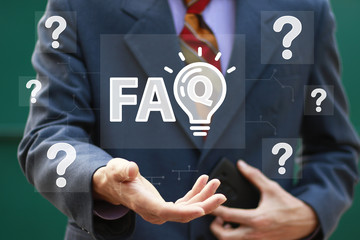 Businessman presses button faq idea on virtual digital electronic user interface question