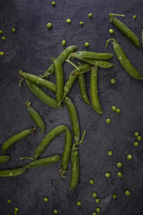 Green peas on dark background