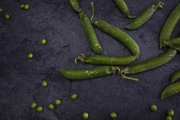 Green peas on dark background