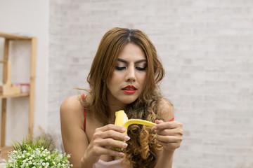 Sexy women in Santa dress are eating delicious bananas.