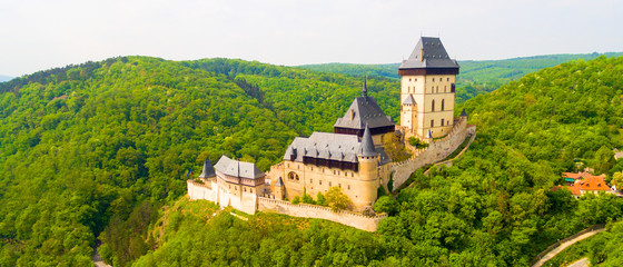 Aerial view to The Karlstejn castle. Royal palace founded King Charles IV. Amazing gothic monument in Czech Republic, Europe. Fototapete