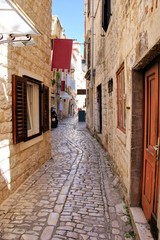 Wall Mural - Pretty medieval lane in the old town of Trogir, Croatia