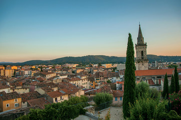 View of the graceful town of Draguignan from the hill of the clock tower under the colorful light of the sunset. Located in the Provence region, Var department, southeastern France