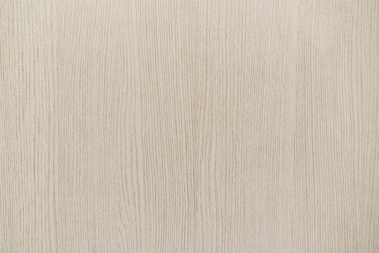 Beige wood background.
