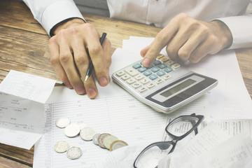 Accountant calculates tax.