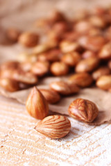 Peeled hazelnuts on the background of wood. useful snack, proper nutrition. how to peel the nuts.