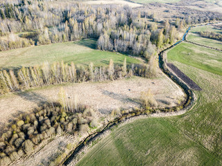 drone image. aerial view of rural area with wawy river ion forests