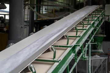 white powder soap on conveyor belt