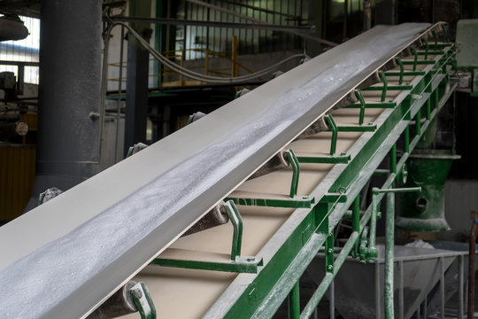 white powder soap on conveyor belt