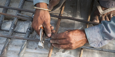 The working hands on steel-fixing