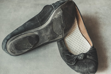 Old worn-out shoes with holes. The concept of poverty.