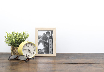 Framed Photo on Wooden Desk Mockup