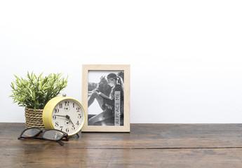Framed Photo on Wooden Desk Mockup