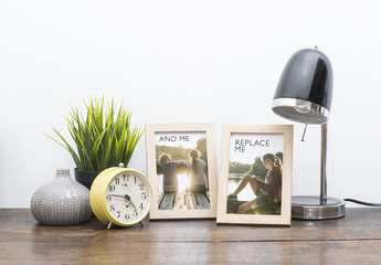 2 Framed Photos on Wooden Desk with Accessories Mockup