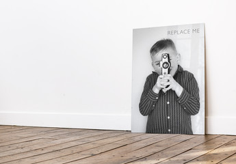Poster Leaning Against Wall on Wooden Floor Mockup