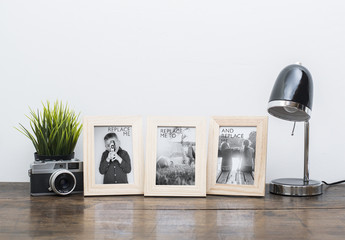 3 Framed Photos on Wooden Desk with Accessories Mockup