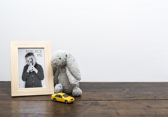 Wood Framed Photo with Children's Toys Mockup