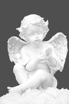 Angel is isolated on gray. Angel is isolated on white. The figure of an angel