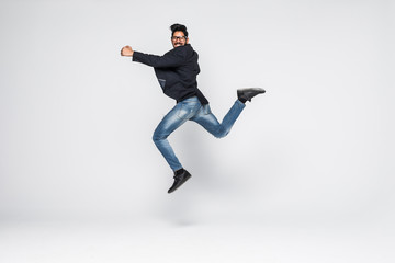 Excited Indian businessman jumping for joy isolated on white background.