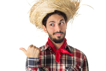 Festa Junina is a brazilian party. Man wearing plaid shirt and straw hat, costume as Caipira.