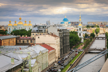 Top view of the center of St. Petersburg: river, cathedrals, old roofs