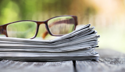 Morning news concept - newspaper and eyeglasses with copy space