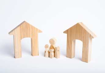 A family with children stand between two houses and make a decision, they make a choice. Adoption of the right decision and priority, the designation of the future family. The search for a new home.