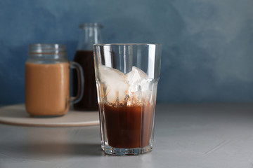 Glass with cold brew coffee on table