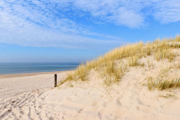 Grass dunes and white sand of beautiful beach. Baltic Sea. Poland