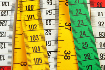 Different measuring tapes, closeup
