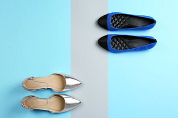 Wall Mural - Different female shoes on color background, top view
