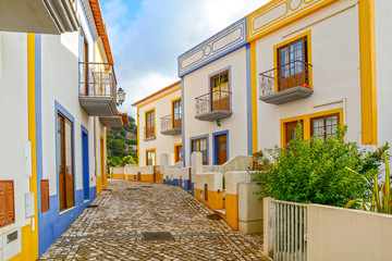 Village street with residential buildings in the town of Bordeira near Carrapateira, Municipality of Aljezur, District of Faro, Algarve Portugal Wall mural