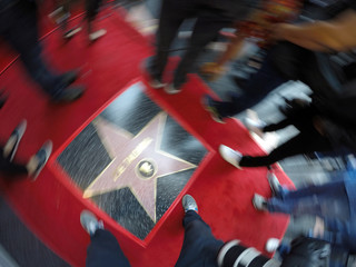 Members of the media walk around the star of actor Zoe Saldana after it was unveiled on the Hollywood Walk of Fame in Los Angeles