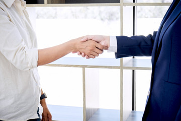 Handshake after good cooperation, Real estate broker residential agent shaking hands with customer after good deal agreement house rent listing contract