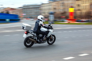 motorcycle rides with speed on city roads