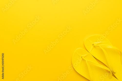 9f1325fb4db1 beach flip-flops on the yellow background with copy space. summer concept
