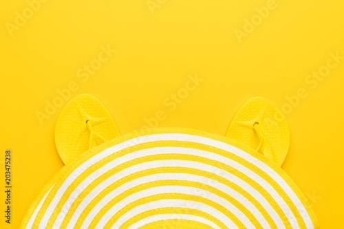 5f8d04f9c99d beach flip-flops and hat on the yellow background with copy space. summer  concept