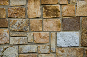 Stone wall. Color, texture and design of this beautiful rock stone wall. Excellent image for background or backdrop.
