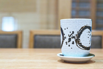 Japanese hot tea cup at restaurant with copy space