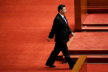 Chinese President Xi Jinping walks to deliver his speech at an event commemorating the 200th birth anniversary of Karl Marx, in Beijing